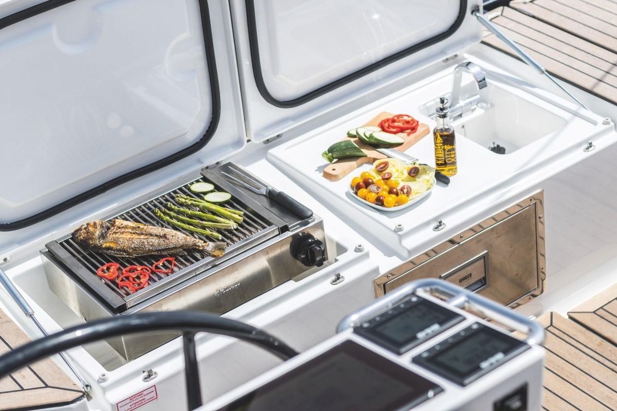 2020 Bavaria C57 Barbecue at its best, in cockpit with sink and fridge . brochure photo