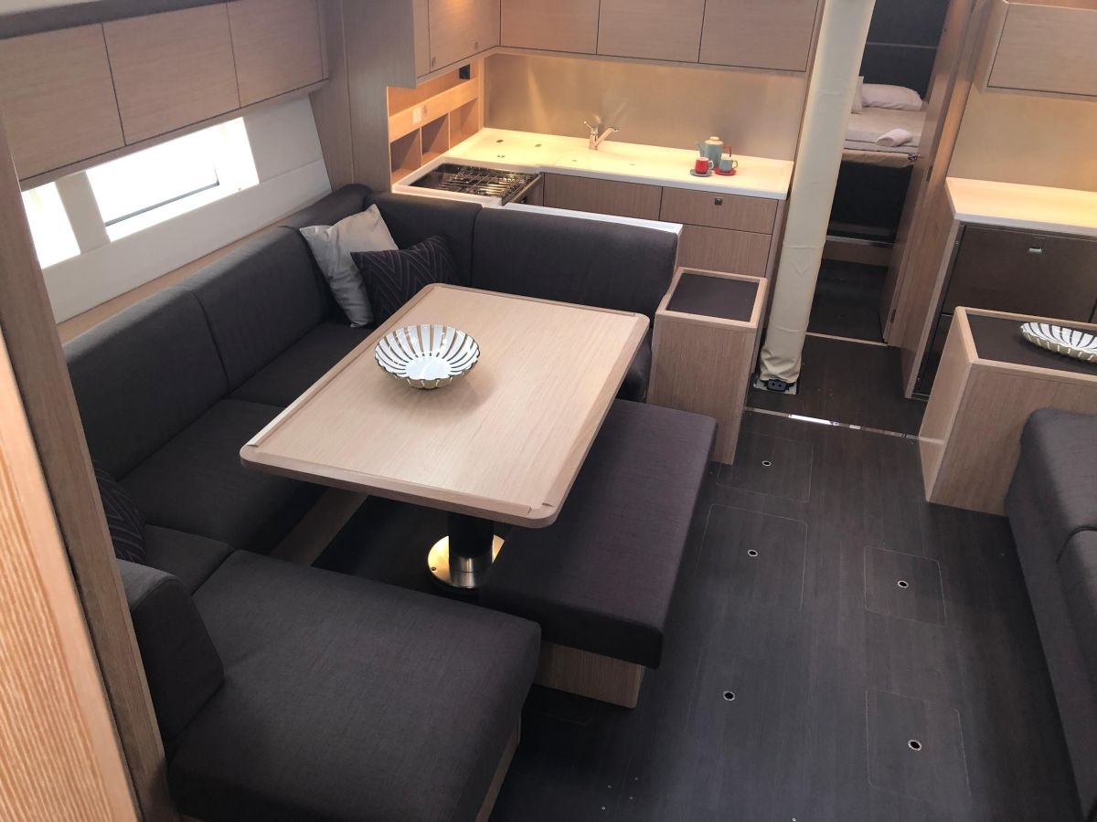 2019 Bavaria C57 Dining table, lowering and folding, convertible into double berth incl. cushion insert